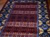 Live in quetta black version ( particolare),  lana annodata a mano su ordito di cotone,  cm.180x270,  2000